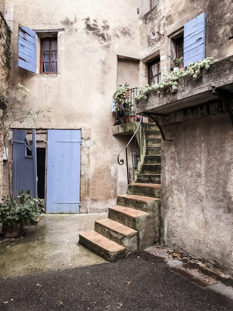 Blue shutters and curved stairs in Lourmarin France Europe Travel