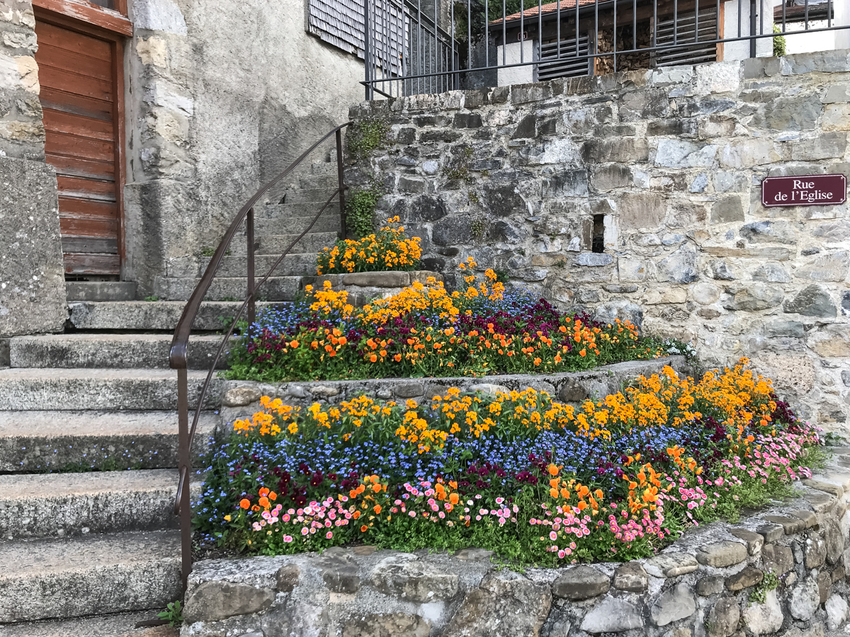 Flowers and steps in Old Town Gruyere Switzerland Europe Travel