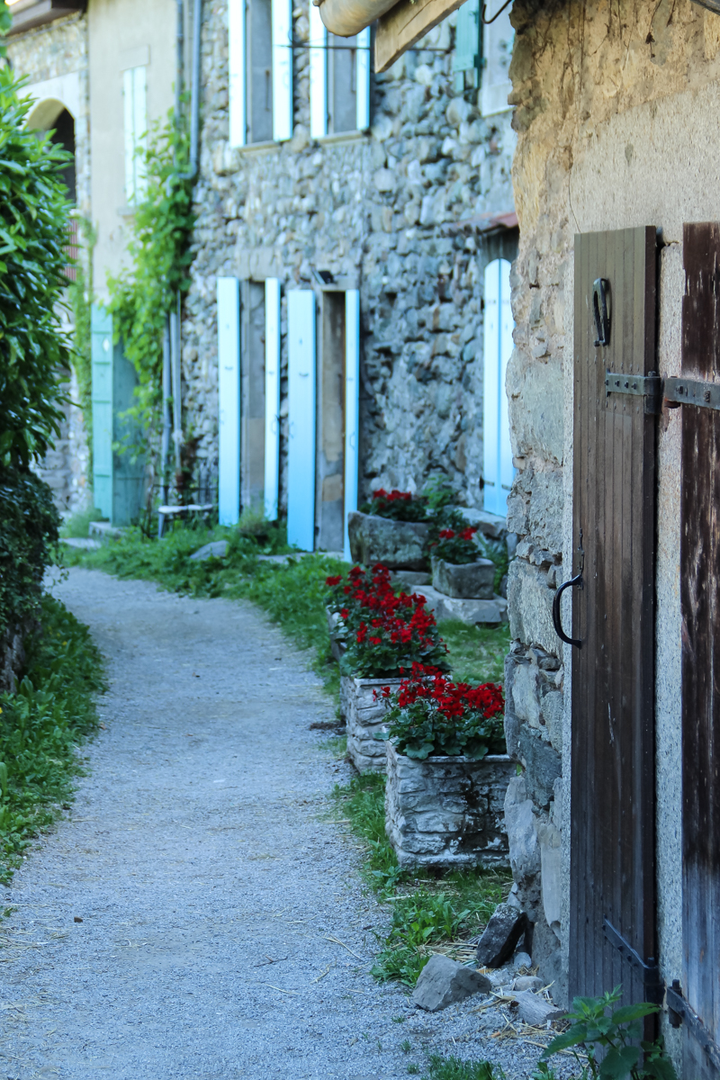 Pathway in Yvoire France with red geraniums Europe Travel