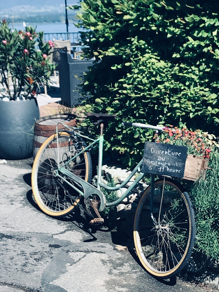 Bike in Yvoire, France with flowers in basket