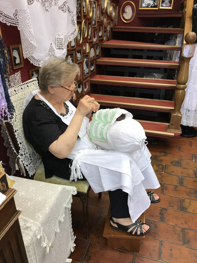 Lady making lace in Burano Italy